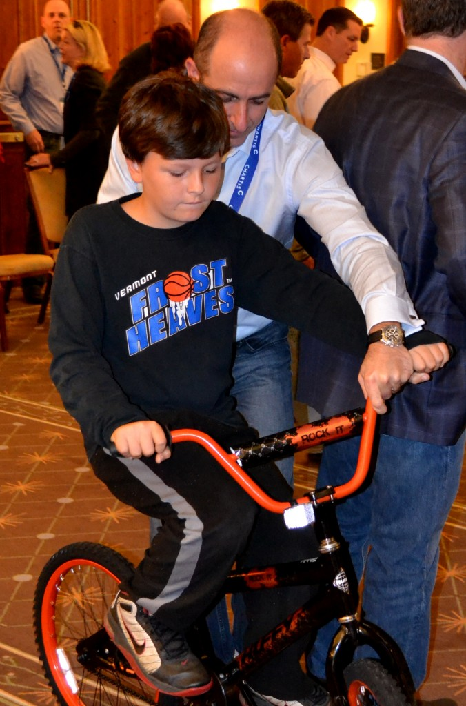 Chartis builds bikes for kids in Stowe VT