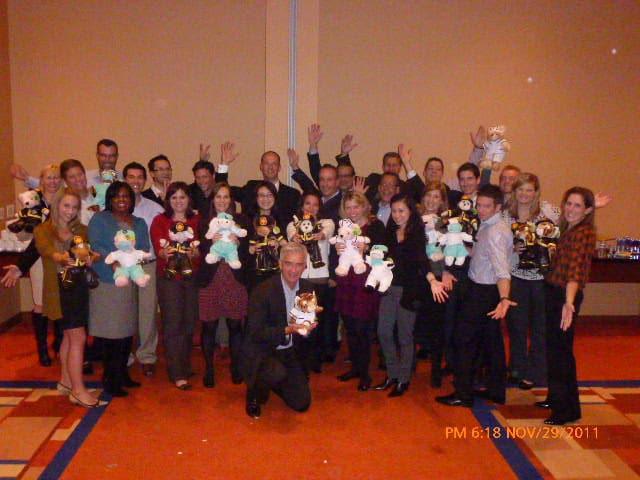 A team from Hilton enjoys a charity teddy bear team building activity.