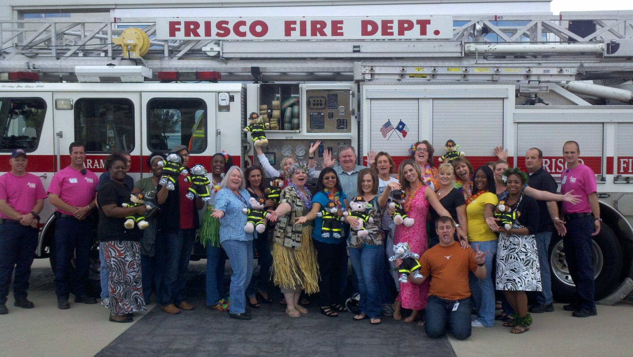 Team in Frisco, TX poses for a teddy bear team building event photo.