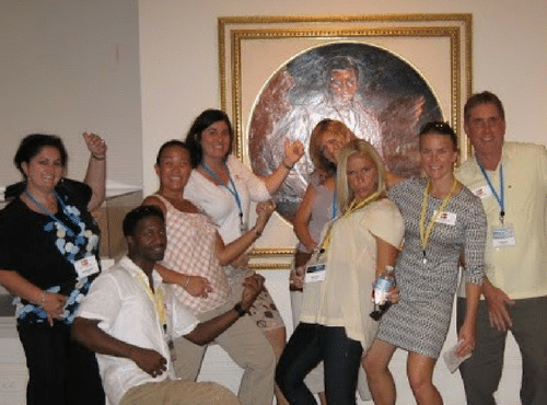 A company's team is having fun at a Museum Quest team building activity.