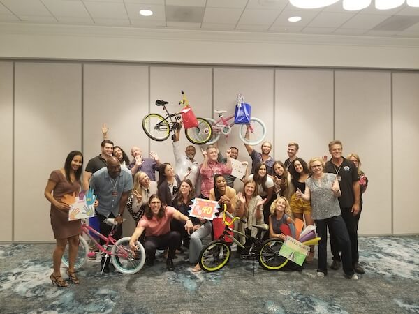 group having fun at a team building activity with bikes