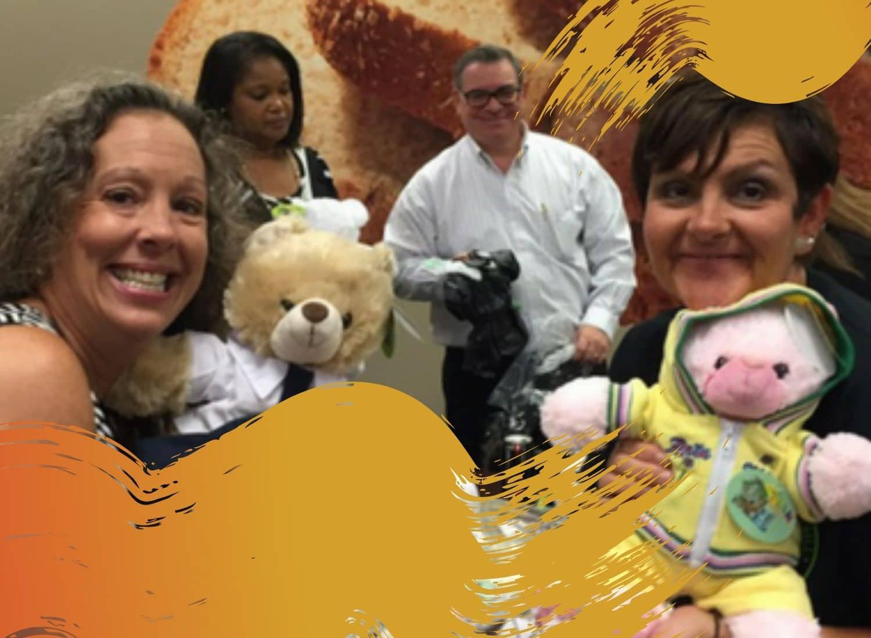 A group from Hilton enjoys a charity teddy bear team building activity.