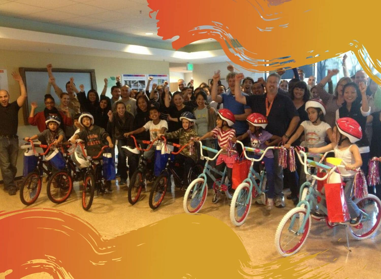 Group enjoying a charity team building Build-A-Bike event.